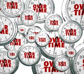 pic of pass-time  - Overtime word on clocks flying by to illustrate time passing as you perform extra or additional work late at your job  - JPG