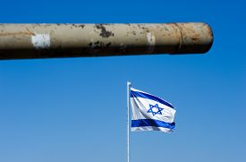 stock photo of panzer  - Barrel of an old centurion tank and the Israelien flag on  - JPG