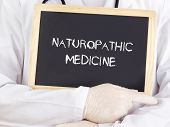 picture of naturopathy  - Doctor shows information on blackboard - JPG