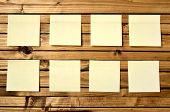 pic of lumber  - Eight blank post notes on lumber background  - JPG