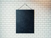 stock photo of canvas  - Blank canvas hanging on the wall decorated with white tiles - JPG