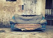 picture of abandoned house  - old abandoned house front with blue sofa - JPG