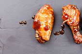 stock photo of chicken wings  - spicy and delicious hot chicken wings in a row - JPG