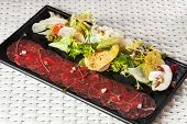 picture of rocket salad  - Beef carpaccio with parmesan cheese - JPG