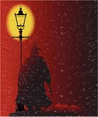stock photo of ripper  - Jack the Ripper standing by a gasl light during a storm with his victim at his feet - JPG
