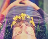 Постер, плакат: a sleeping hipster lying in tall grass with dandelions in his epic beard taking a nap toned with a r