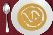 image of butternut  - Traditional French butternut squash cream soup with soured cream and toasted squash seed garnish - JPG