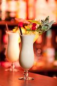stock photo of pina-colada  - Pina Colada cocktail shot on a bar counter in a nightclub - JPG