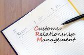 picture of customer relationship management  - Customer relationship management concept Notepad and pen - JPG