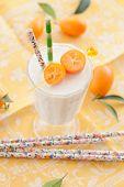 pic of kumquat  - Glass of milkshake made with fresh organic kumquats - JPG