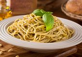 pic of pesto sauce  - A delicious bowl of fresh spaghetti with green basil pesto sauce.