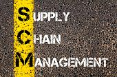 picture of supply chain  - Business Acronym SCM as Supply Chain Management. Yellow paint line on the road against asphalt background. Conceptual image - JPG