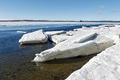 stock photo of crevasse  - Sea ice is destroyed in the spring White sea Russia - JPG