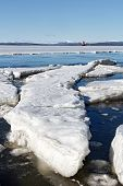foto of crevasse  - Sea ice is destroyed in the spring White sea Russia - JPG