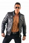 stock photo of jacket  - Handsome muscle man wearing leather jacket on naked torso, isolated on white background looking at camera