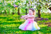 stock photo of fairy  - Child playing with a bird - JPG