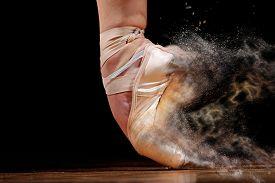foto of  dancer  - dancer in ballet shoes dancing in Pointe on a wooden floor - JPG