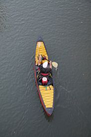 picture of kayak  -  a kayaker in a kayak or canoe paddling down a river  - JPG