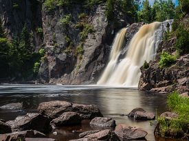 stock photo of baptism  - This is the High Falls of Baptism River at Tettegouche State Park in the Lake Superior North Shore area in Minnesota - JPG