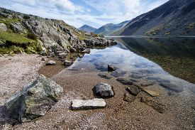 picture of reflections  - Stunning landscape of Wast Water and Lake District Peaks on Summer day reflected in perfect lake - JPG