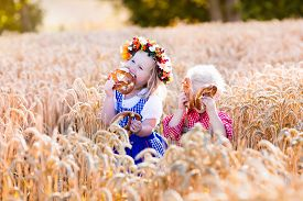 pic of pretzels  - Kids in traditional Bavarian costumes in wheat field - JPG