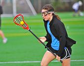 Lacrosse girl cradling the ball