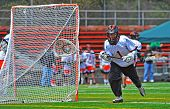 Lacrosse goalie with the ball