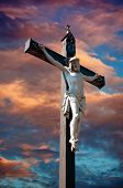 picture of crucifiction  - A statue of Jesus Christ crucified against dramatic sky - JPG