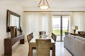 View of dining table and view out sliding glass doors