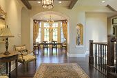 image of entryway  - Grand foyer with area rug and view to dining room - JPG
