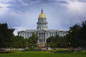 Denver Capitol in Summer. Dark blue sky behind brightly lit gold domed capitol