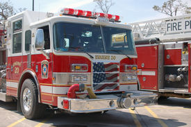 picture of katrina  - a pair of fire trucks lined up in a parking lot after katrina - JPG