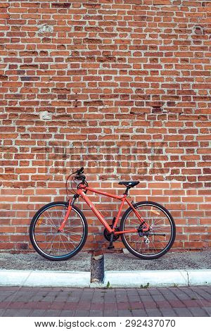 A Red Bicycle In Summer