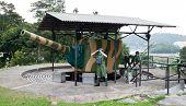 SINGAPORE - JUNE 20:Dummy soldiers at gun battery in Military museum Fort Siloso, June 20, 2009, Sentosa island, Singapore. Siloso is last remaining coastal gun battery from 12 batteries in Singapore
