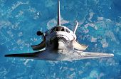 Spaceship On The Flight. Space Shuttle Close-up. Flying Rocket. View Of The Planet Earth  From Outer poster