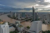 Aerial View Over Bangkok Modern Office Building In Bangkok Business Zone Near The River With Sunset  poster