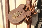 Lock. Antique Lock and Gate. Rusty Lock and Gate Vintage. Antique rusted iron gate. poster