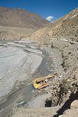 foto of kali  - Fallen dredger at the Kali Gandaki river valley floor - JPG