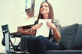 Woman Enjoying Good News In A Letter. Happy Brunette Enjoying Good News In Written Notice At Home. E poster