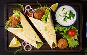 Tortilla Wrap With Falafel And Fresh Salad. Vegan Tacos. Vegetarian Healthy Food. Top View poster