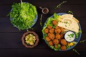 Falafel, Hummus And Pita. Middle Eastern Or Arabic Dishes On A Dark Background. Halal Food. Top View poster