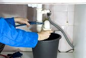 picture of choke  - plumber repairing a choked - JPG