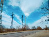 High Power Electricity Poles In Urban Area. Energy Supply, Distribution Of Energy, Transmitting Ener poster