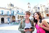 Tourists couple travel in Havana, Cuba having fun. Young multiracial happy couple on backpacking vac