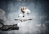 Closeup Of Waitresss Hand In Glove Presenting Flying Aerostats On Metal Tray With Blue Cloudy Skysca poster