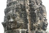 Carved rock faces of protective dieties at Angkor Wat, Cambodia