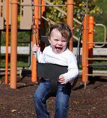 Little Toddler Girl On A Swing