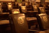 pic of texas star  - Classic brown leather chairs at Texas capitol.