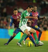 BARCELONA - JAN 15: Roque Santa Cruz(R) of Real Betis vies with Adriano Correia(L) of FC Barcelona d