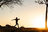 Silhouette Of Man Running. poster